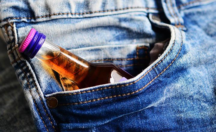 alcohol bottle in jeans pocket