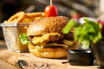 burger on wooden plate