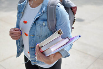 female student with books in her hand