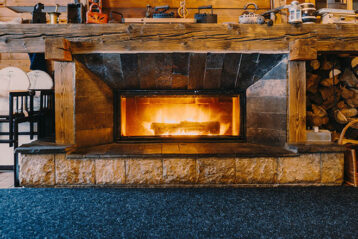 fireplace and blue carpet