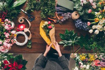 florist at work preparing a flower bouquet