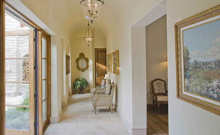 Hallway with furniture and large open doors