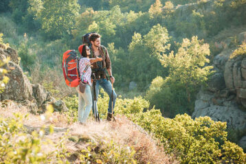 hiking couple admiring the scenery
