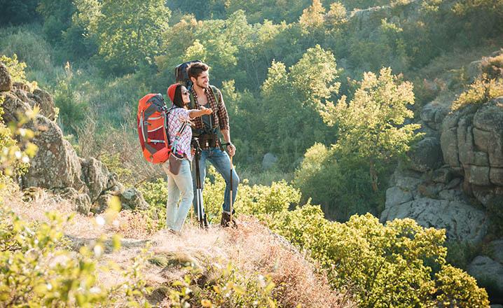 hiking couple admiring the scenery