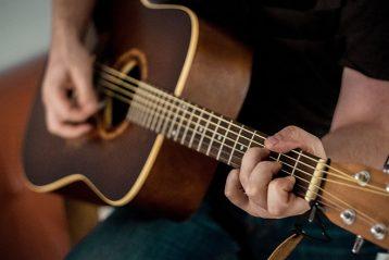 man playing guitar beginner