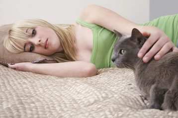 teenage blonde girl with black cat