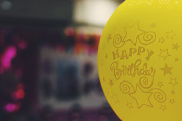 yellow happy birthday balloon