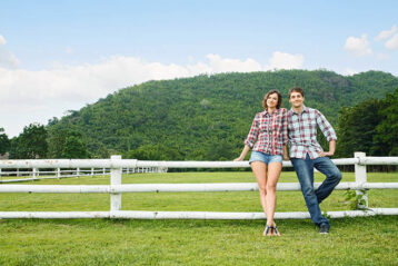 young couple near plot of land